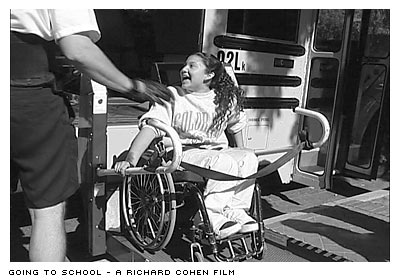 Ana in wheelchair on bus lift